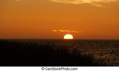 red-hot sun setting