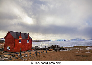 Red house in the village of Khuzhir on Lake Baikal, Russia