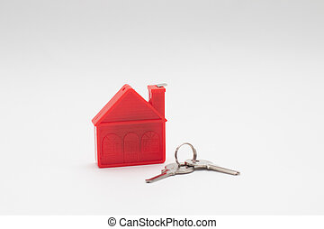 Red House model with keys. Real estate.