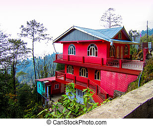 Red house on a hill slope