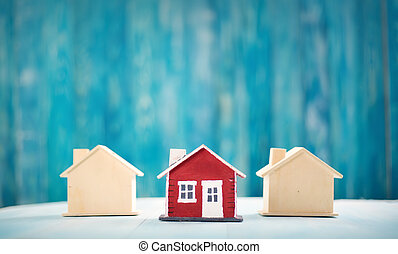 Red house on wooden background