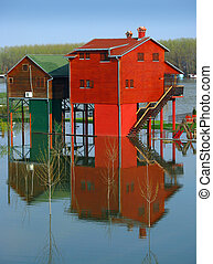 Red houses and flooding river