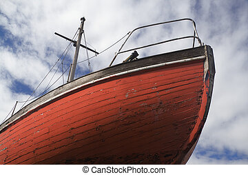 Bow of boat in dry dock showing hull planks