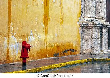 Red hydrant on sidewalk