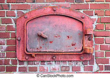 The old red door of the brick incinerator, from the turn of the 20th century.
