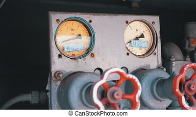 Red Industrial Tap Water and Pressure Indicators on the Fire Truck. Close-up. View of firefighting machine hydraulics tool of fire engine.