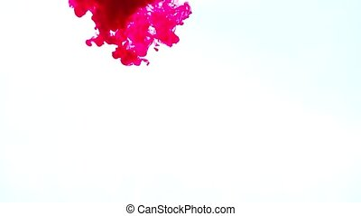Red ink in water on a white background HD