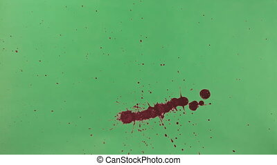Red Ink Splatter Over Green Screen Background - Red ink...