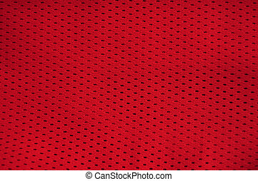 Close up of red polyester nylon red basketball sportswear shorts to created a textured background.