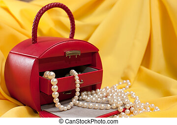 Red jewellery case on the yellow background