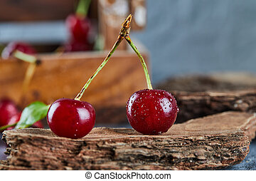 Red juicy cherry berries on a wooden piece. High quality photo