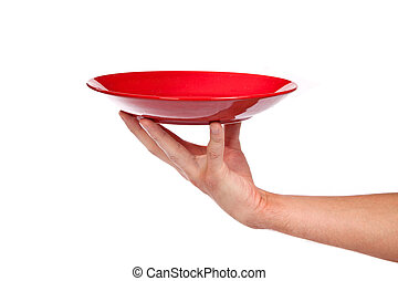 Red kitchen plate on a hand isolated