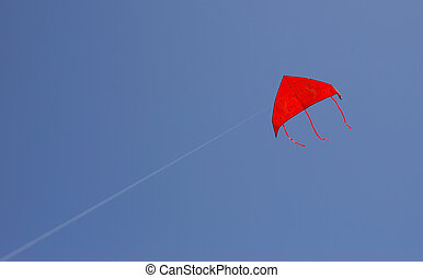 red kite - a red kite is flying in a blue sky
