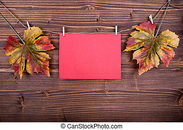 Red Label With Autumn Leaves On A Line