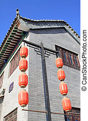 red lantern hanging in the sky