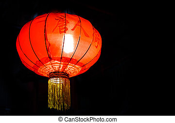 Red lantern on the roadside at night
