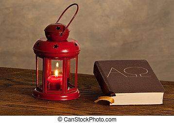 Red lantern with bible on the wooden desk