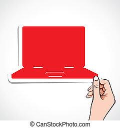 red laptop sticker in hand