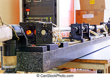Red laser in laboratory - Red laser on optical table in...