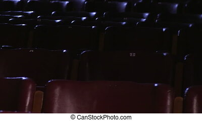 Red leather cinema chairs - A sliding shot of to the left of...
