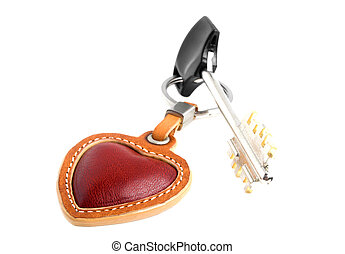 Red leather heart with a key on a white background