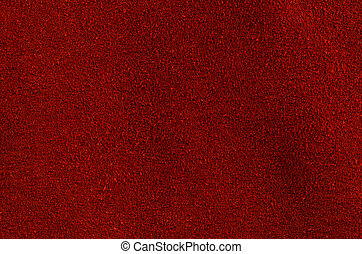 Red leather texture closeup detailed background.