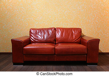 red leather sofa in room ith wood floor