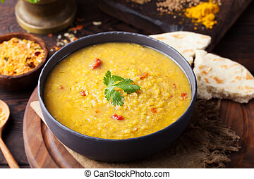 Red lentil Indian soup with flat bread. Masoor dal. - Red ...