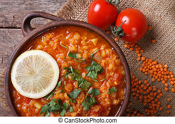 Red lentil soup with tomatoes and lemon horizontal. top view...