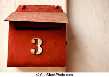 Red letterbox on cream wall, number three - Retro style red...