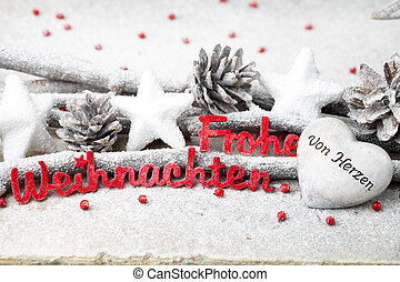 Red letters with german Frohe Weihnachten means Merry Christmas