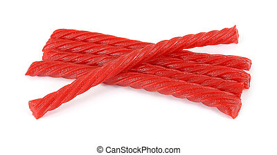 Red licorice - Several pieces of red licorice on a white...