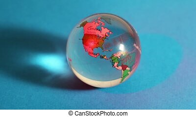 Red light flashes on transparent sphere with world map on it