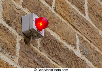 Red light on a brick wall