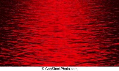 red light reflecting on ocean