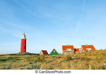 Red lighthouse in the dunes