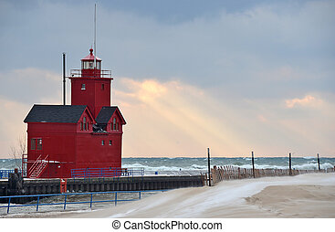 red lighthouse in winter