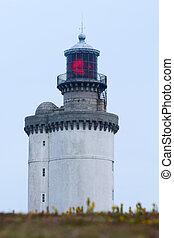 stiff lighthouse illuminated at dusk ouessant island, brittany, france