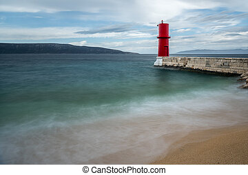 Red lighthouse of Cres on a cloudy day in spring