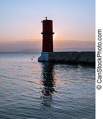 Red lighthouse of Cres on a sunny evening in spring