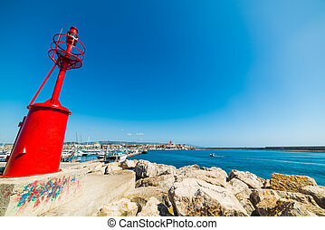 red lighthouse under a clear sky