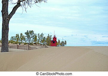 red lighthouse with sand drift