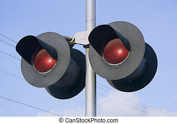 Red Lights - The double red lights of a railroad crossing...