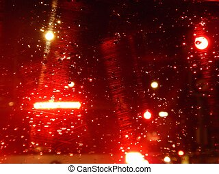 red lights - red traffic lights during a rainy night on the...