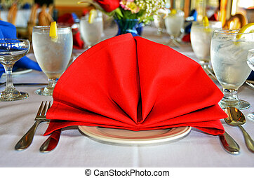 red linen dinner napkin - Red fan napkin on a dinner party...