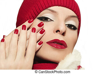 Red lips and manicure.