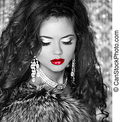 Red lips, Beautiful Woman in Luxury Fur Coat. Black and white photo