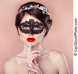Red lips. Mask. Beautiful girl model with fashion jewelry, manicured nails. Makeup. Hairstyle.
