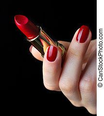 Red lipstick in hand