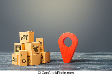 Red location pointer geolocation symbol and cardboard boxes...